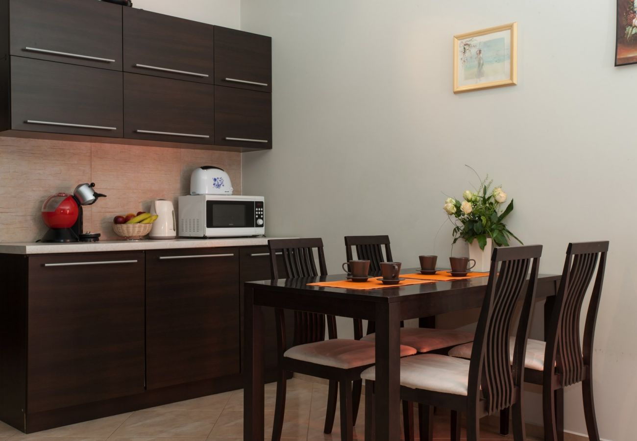 kitchen, table, chairs, microwave, toaster