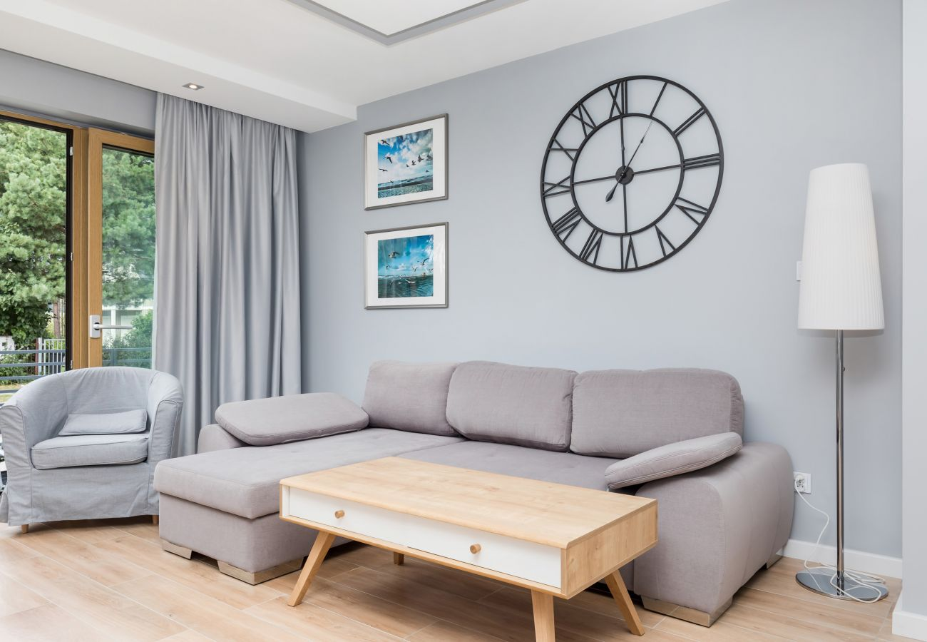 living room, lamp, sofa, coffee table, clock, recliner