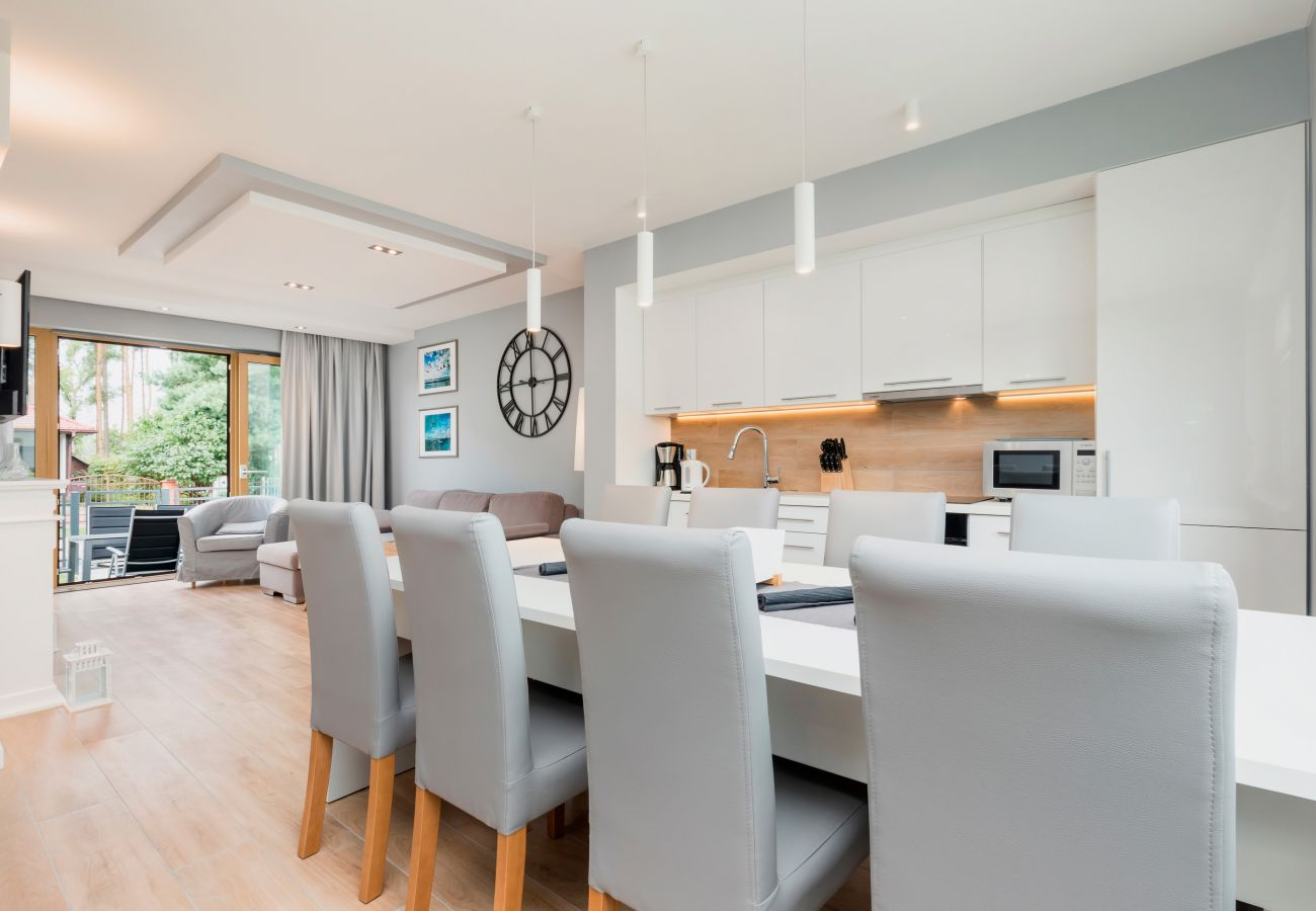 dining area, dining table, chairs, kitchenette, coffee machine, kettle, sink, microwave, stove, oven