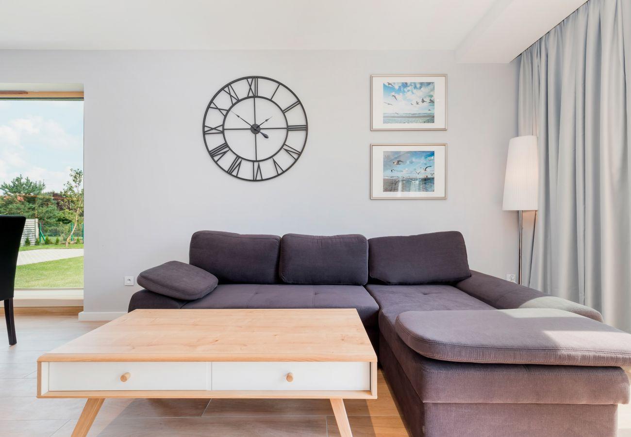 living room, clock, coffee table, sofa, window, outdoor view, rent