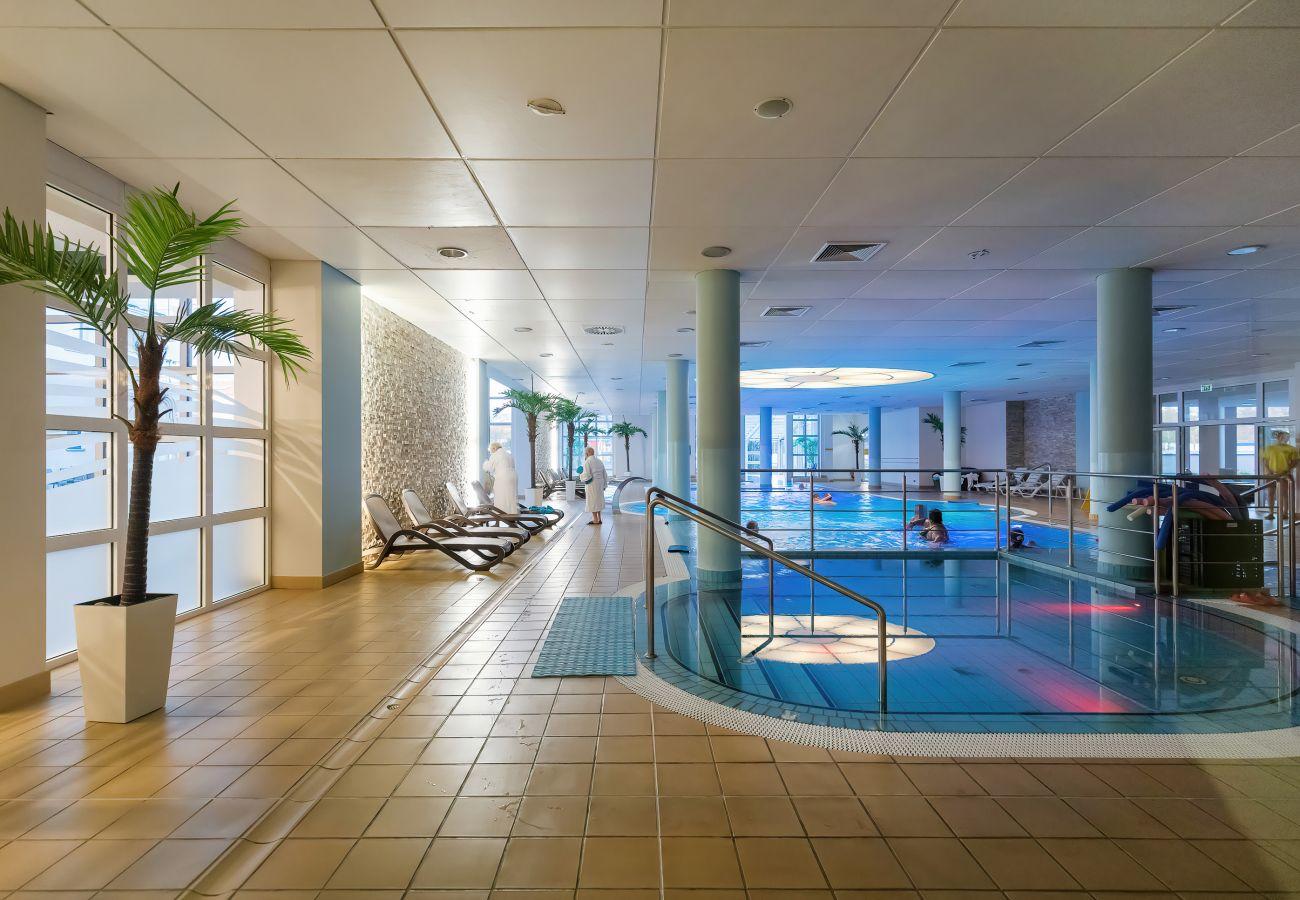 swimming pool, paid, apartment building, apartment building interior, amenity, rent