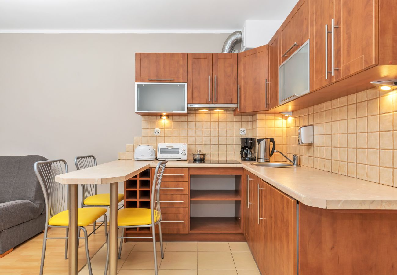 kitchen, kitchenette, kettle, coffee maker, oven, fridge, cupboards, dining area, kitchen island, chairs, studio, interior, rent