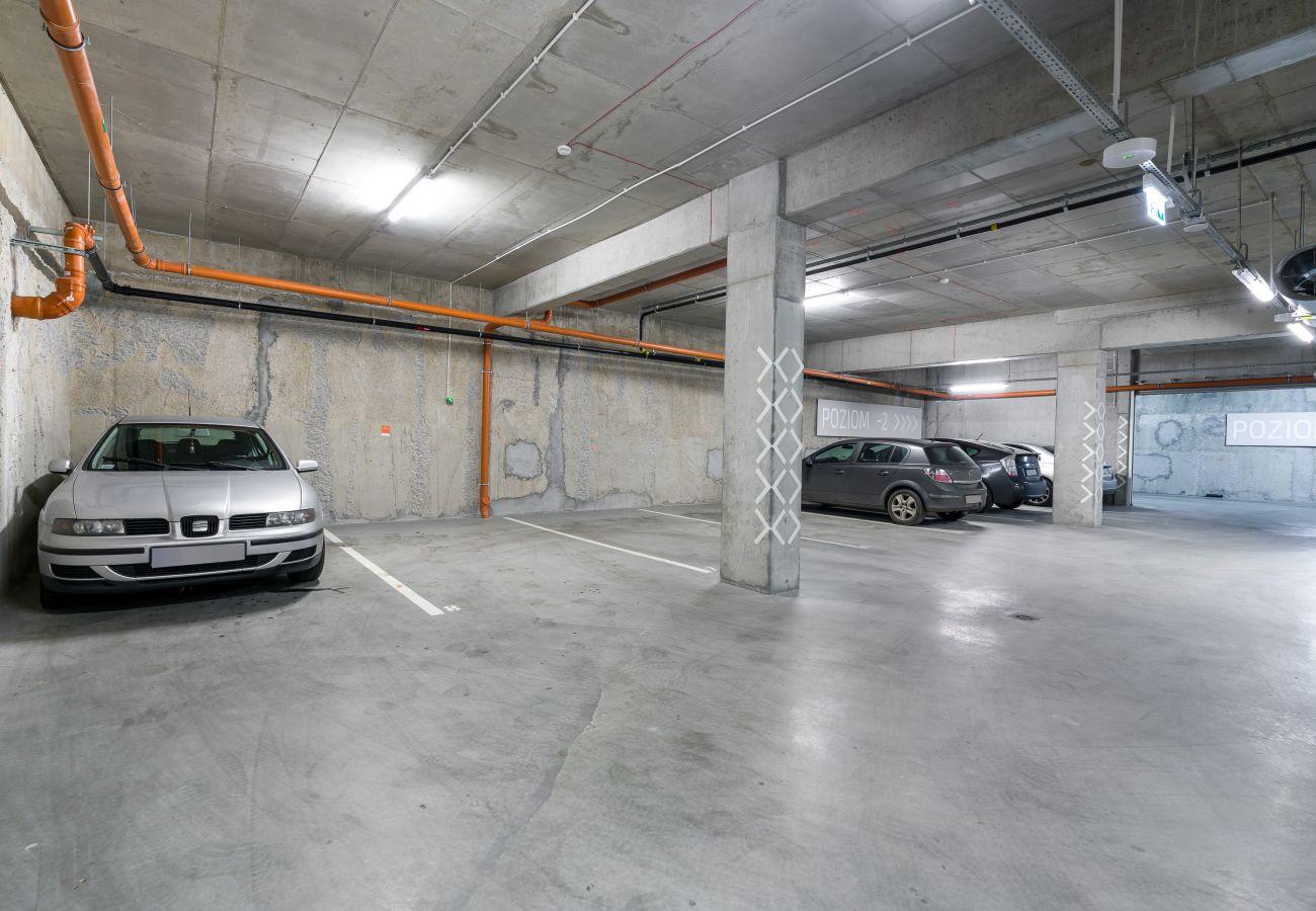 garaż, parking, parking podziemny, apartament, budynek mieszkalny, wnętrze, wynajem