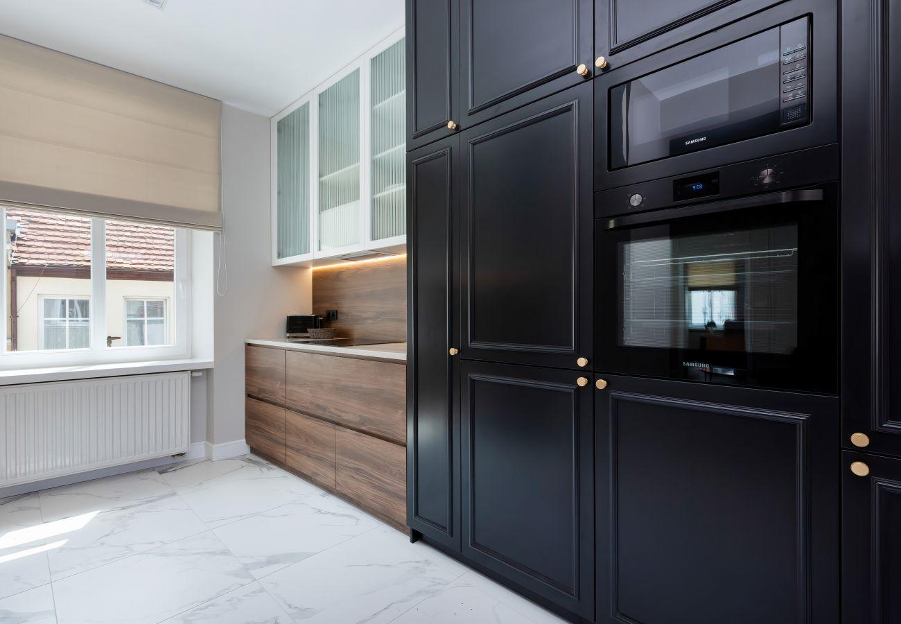 apartament, wynajem, kuchnia, lodówka, piekarnik, zmywarka, ekspres do kawy, wnętrze