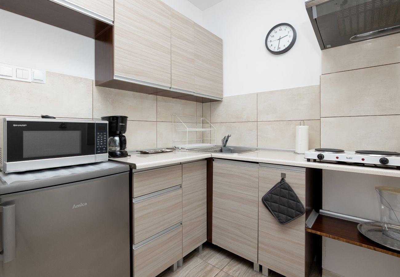kuchnia, ekspres do kawy, lodówka z zamrażarką, jadalnia, apartament, wynajem